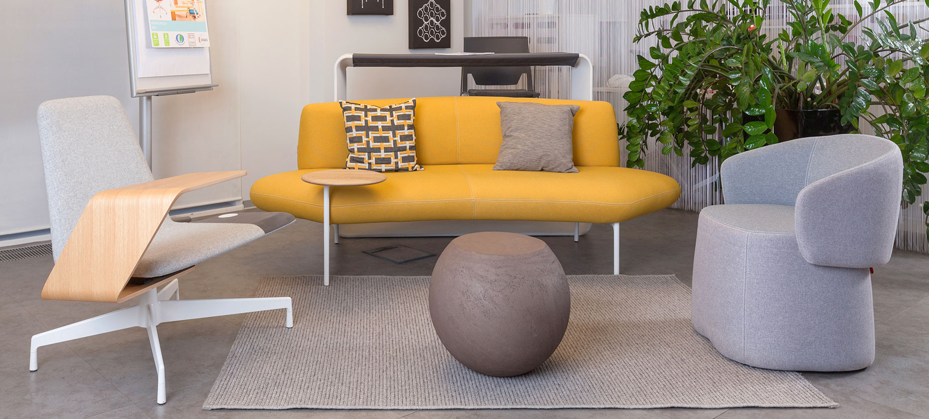 A cozy lounge area is furnished with an inviting combination of a Chick pouf, Feather sofa, Harbor Work Lounge, and Cappellini's Bong coffee table. 
