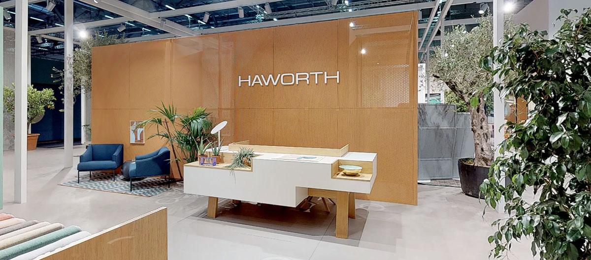 A warm welcome awaits you at reception on the Haworth Orgatec booth.
