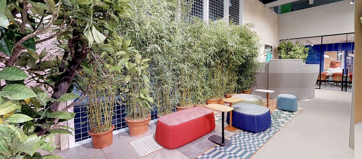 Superpouf cushions create a comfortable lounge area amidst the Vertical Garden.