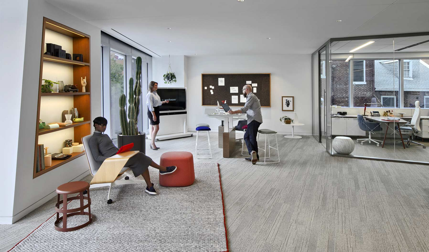 This Social Space demonstrates how a zone can be layered with various postures and become an effective collaboration tool for the entire office. Anchored at the end of the floor plate with both technology and tactile pin up space, and adjacent to both private offices and workstations, it's a spot where multiple people can efficiently come together to collaborate in the open office.