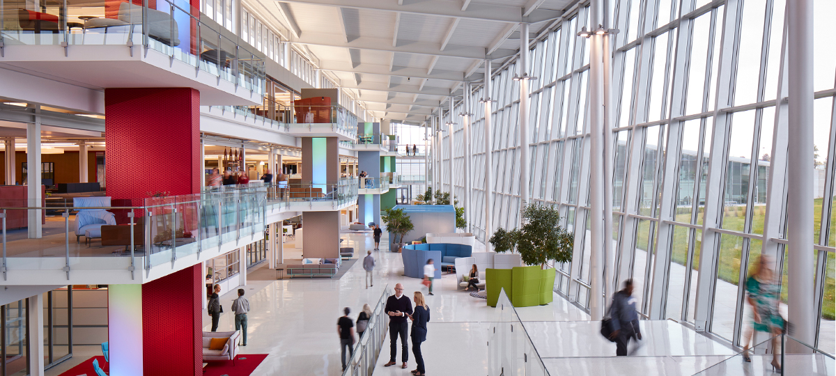 The atrium at One Haworth Center serves as a major thoroughfare for the building as well as an active collaboration zone. The vertical columns at each balcony serve as wayfinding for different office zones, and are a striking design feature that further elevate the buildings remarkable architecture.
