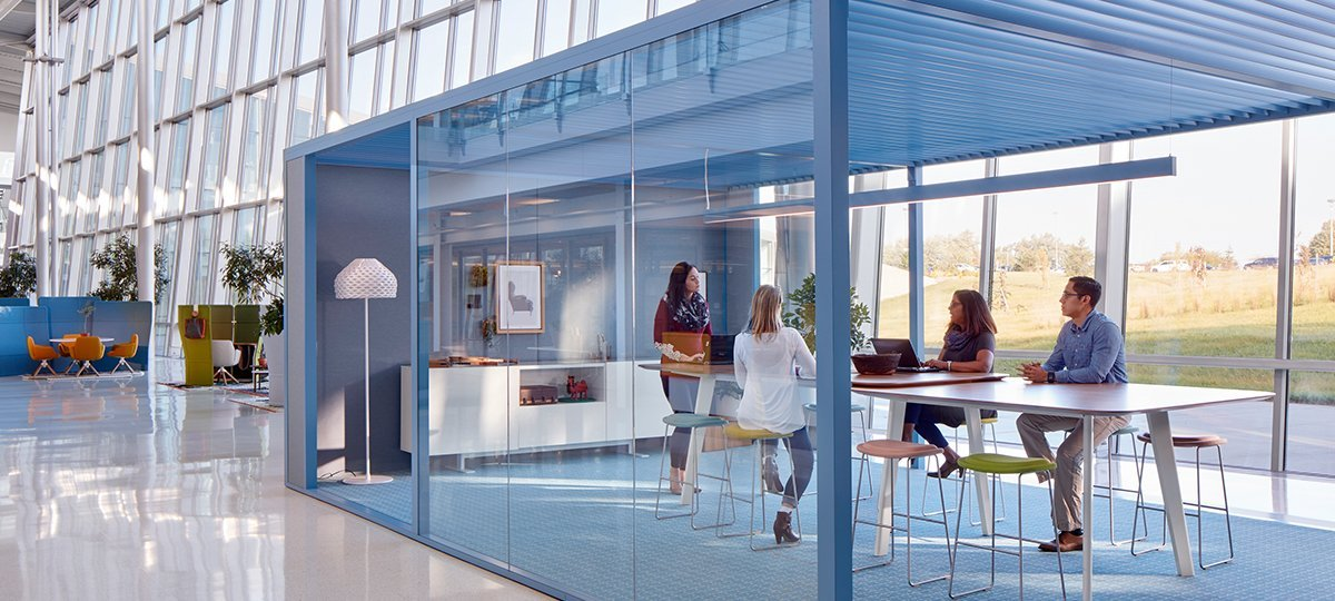 This meeting space was an design exploration of creating space within a space. The absense of doors, use of glass, gracious openings, and a louvered ceiling demonstrate how an enclosure can be open to the surrounding space and simultaneously provide privacy.