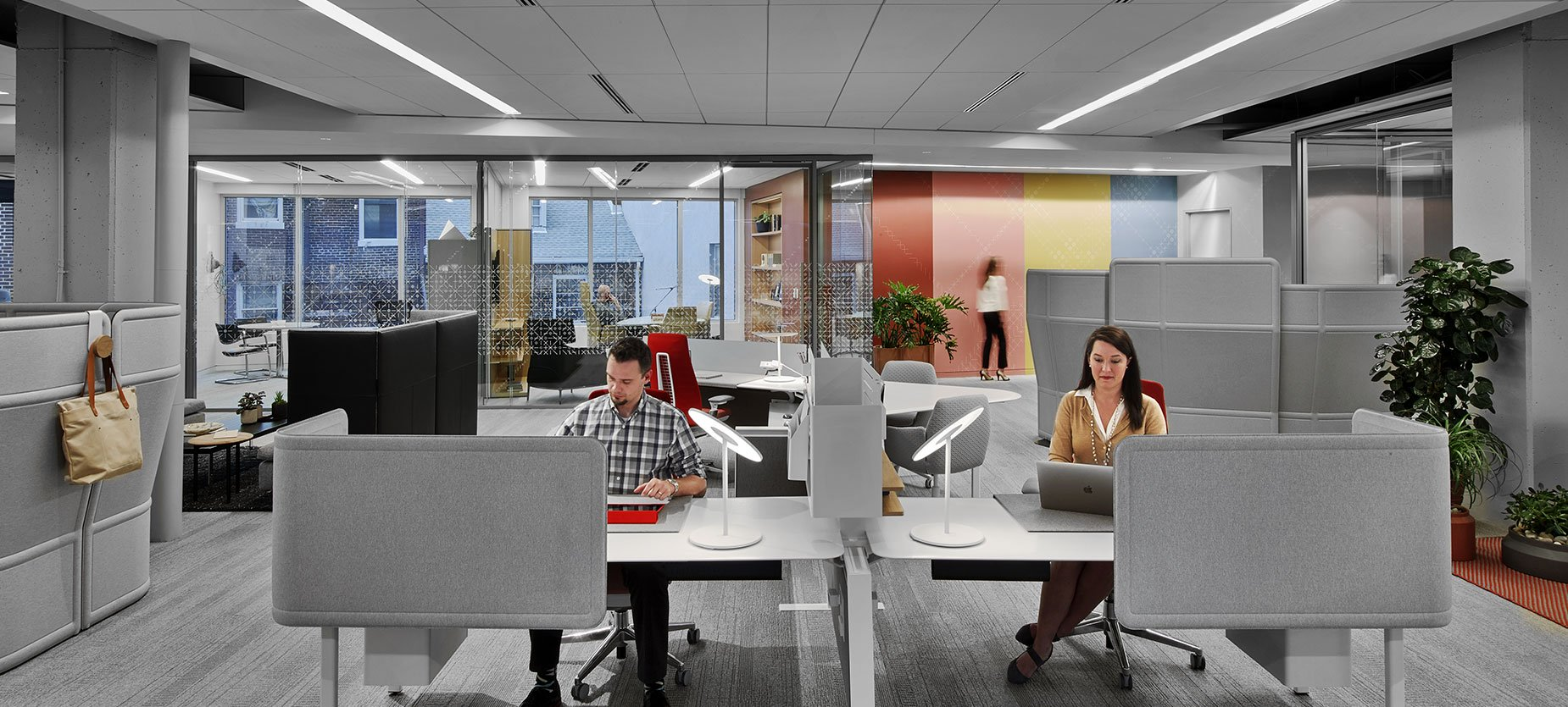 This simple application provides workspaces for those on a team who collaborate and who work primarily in the digital realm, with minimal storage needs. It not only grants them user control over posture, but integrates a small meeting table into the application. The modest panel height provides power access while retaining visual connectedness to their team and the office environment.