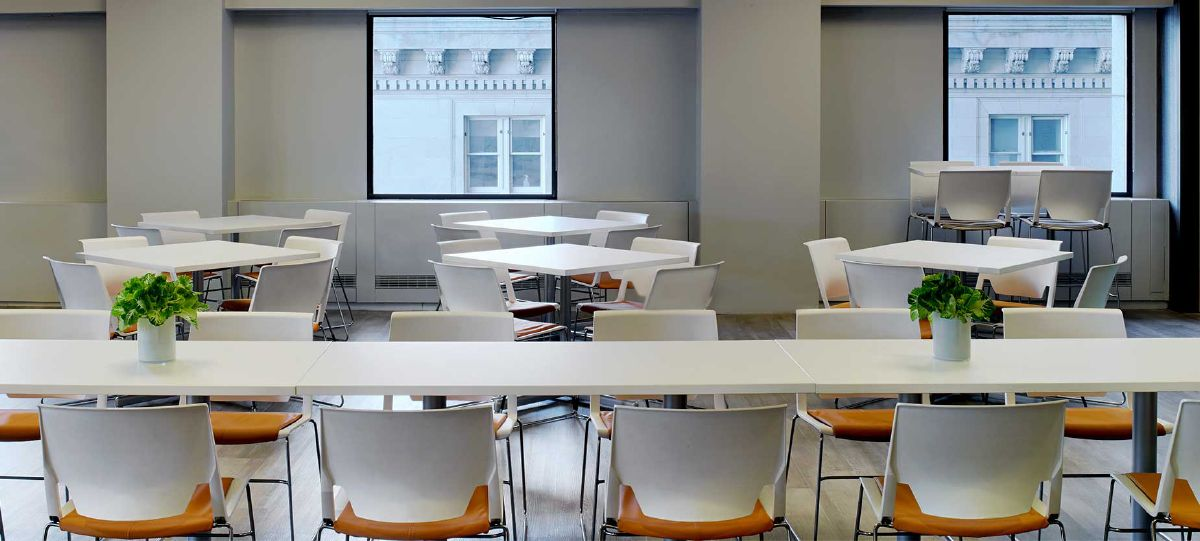 Adjacent to the commercial kitchen, this flexible space can host lunch or be rearranged for activity-based training.