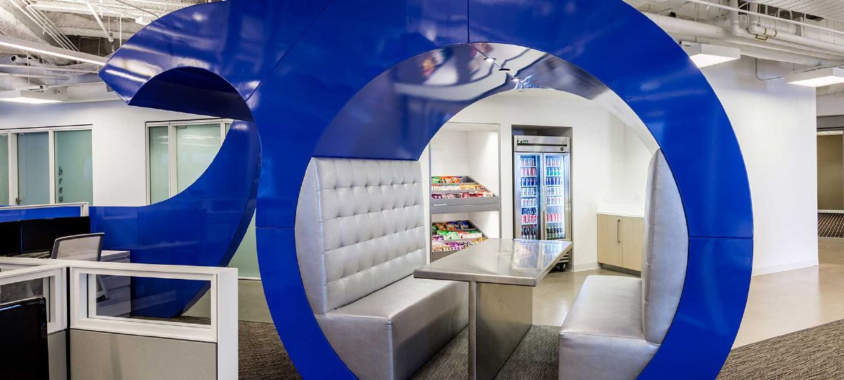 "Embedded with the individual workspaces are these unique ""pods"" for meetings and gathering. Snacks are always readily available also to fuel the brainstorming sessions."