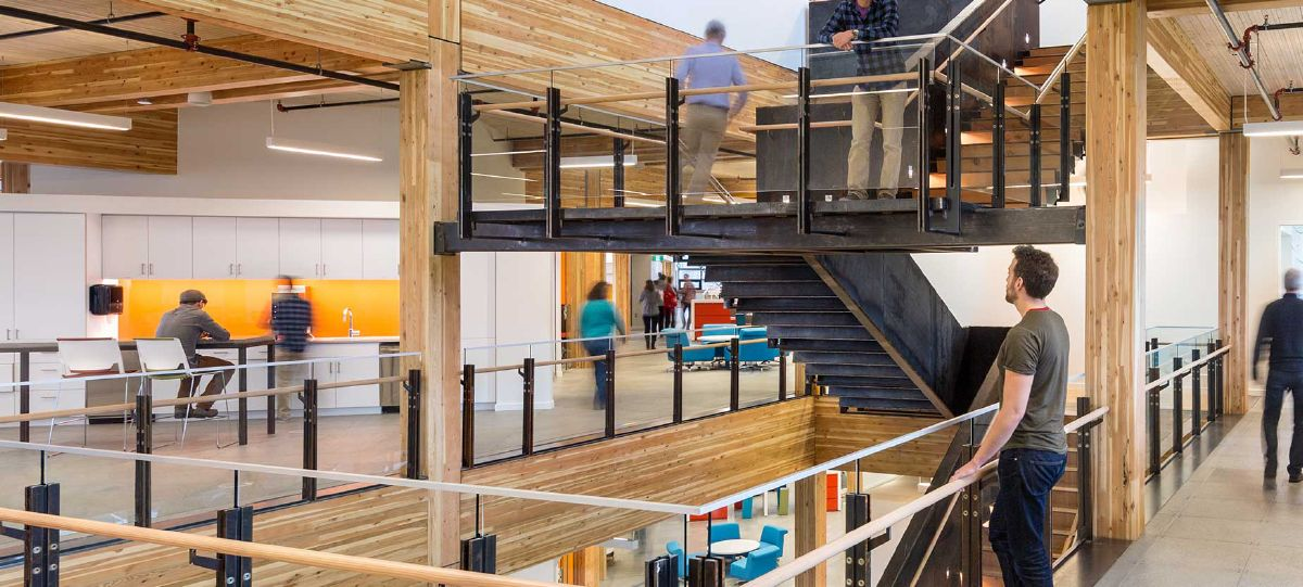 An atrium space with a feature stairway gives people connectivity and visibility right in the heart of the building's 112,000 square foot space, enabling sight lines and connection among people.