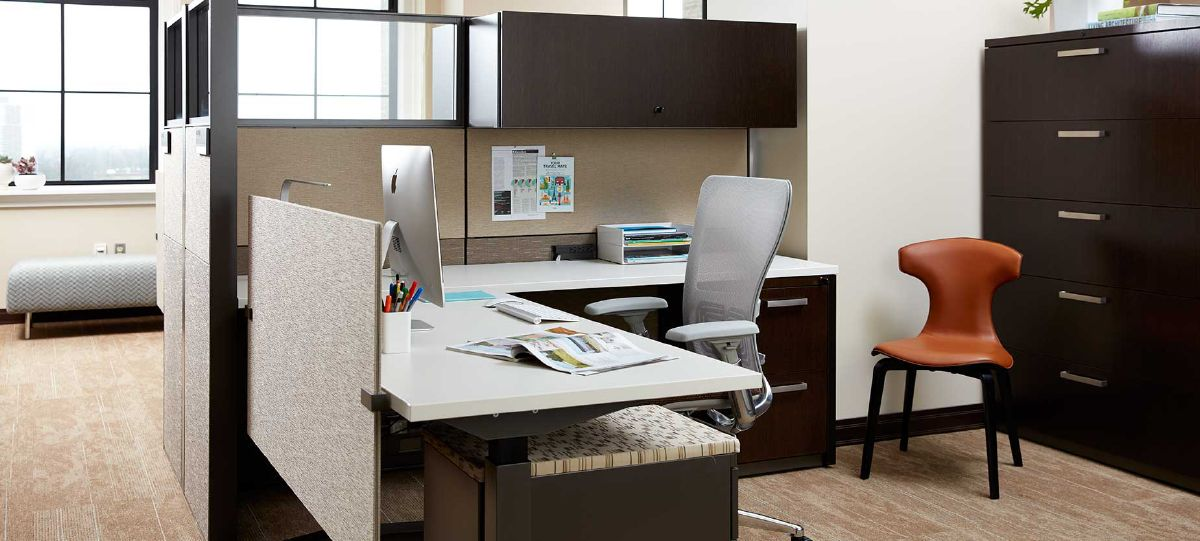 In addition to open collaboration areas, individual workspaces in the WMU Alumni Center offer flexibility to employees by incorporating adjustable desks.