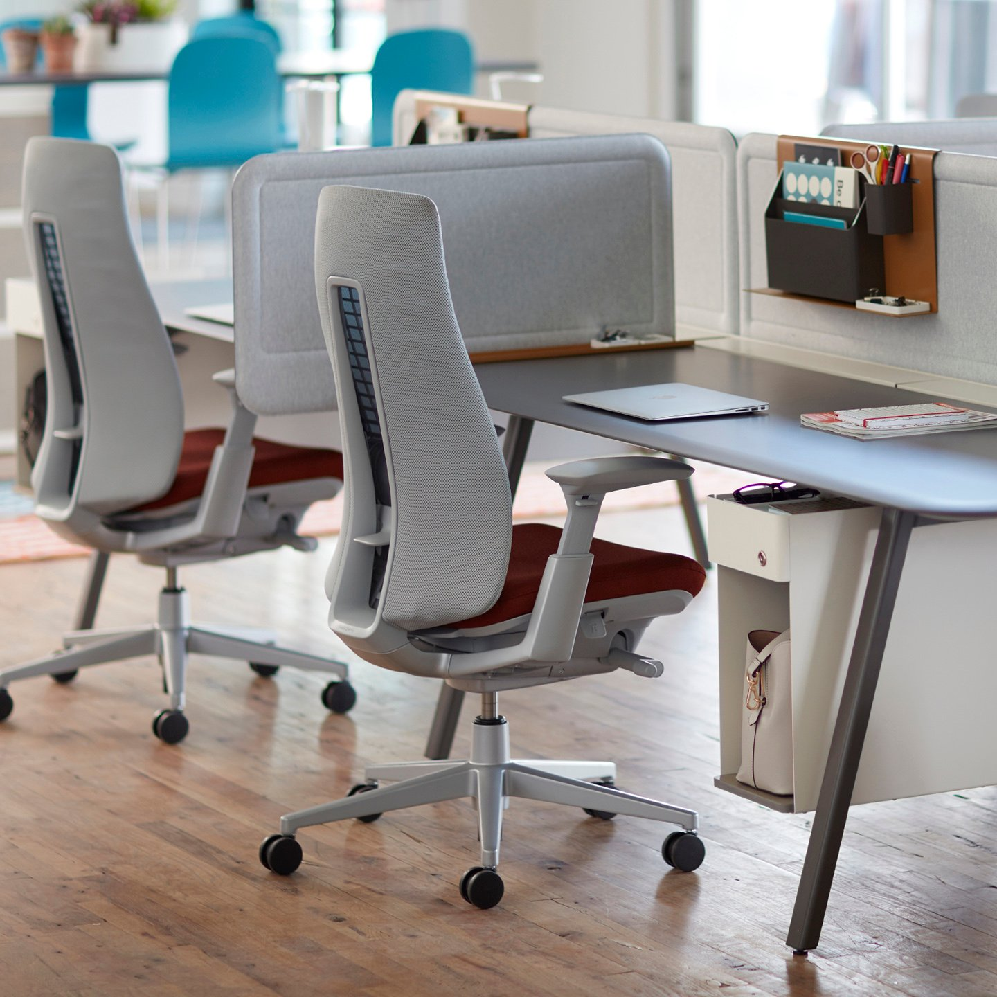 Open office area features Intuity Benching with Fern Task chairs, Active Components, and an Openest Chick Pouf./